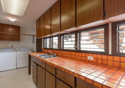 More kitchen counter space and washer and dryer on the side in Aiea Heights house for sale