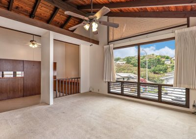 Living room opening up to dining room in Aiea Heights house for sale