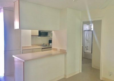 Full view of kitchen and bar counter in Waikiki apartment for sale