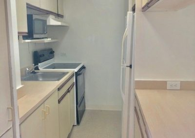 Side view of kitchen for Waikiki apartment for sale