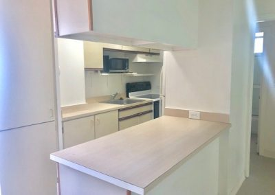 Bar counter next to next to kitchen in Waikiki apartment for sale