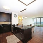Kitchen over looking living room with ocean views in Kakaako condo for sale